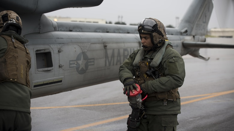 Sgt. Kevin Carpio, a UH-1Y crew chief with Marine Light Attack Helicopter Squadron 267, currently supporting Marine Aircraft Group 36, 1st Marine Aircraft Wing, III Marine Expeditionary Force through the unit deployment program, finishes refueling the UH-1Y Venom at Marine Corps Air Station Iwakuni, Japan, March 11, 2017. The squadron, based out of Camp Pendleton, California, validated the long-range capability of the auxiliary fuel tanks on their H-1 platform helicopters by flying 314 nautical miles during one leg of the four-day mission, March 10.