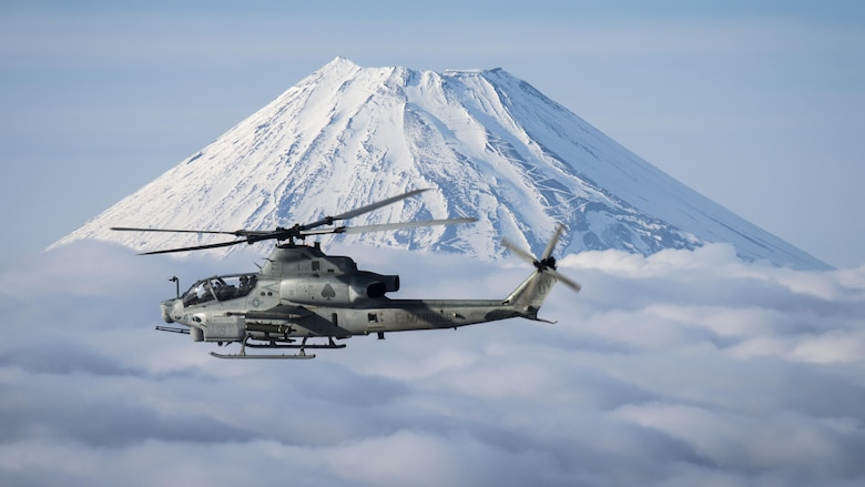 Marine Light Attack Helicopter Squadron 267 AH-1Z Viper and UH-1Y Venom helicopters past Mount Fuji, Shizuoka, Japan, March 12, 2017. The squadron, currently supporting Marine Aircraft Group 36, 1st Marine Aircraft Wing, III Marine Expeditionary Force through the unit deployment program, validated the long-range capability of auxiliary fuel tanks on their H-1 platform helicopters by flying 314 nautical miles during one leg of the four-day mission, March 10.