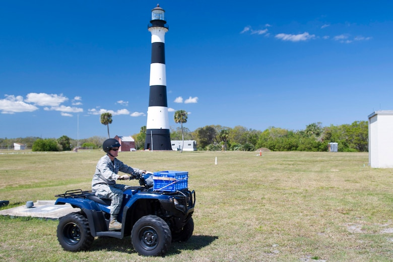 Brig. Gen. Wayne Monteith, 45th Space Wing commander, rides an All-Terrain Vehicle (ATV), during an environmental conservation immersion March 17, 2017, at Cape Canaveral Air Force Station, Fla. Prior to operating the ATV, members of the 45th Civil Engineer Squadron conducted a training session to ensure safety requirements and Personal Protective Equipment were followed.  (U.S. Air Force photo/Matthew Jurgens)