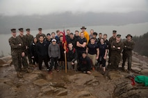 Recruiting Sub-Station Gresham, stands at the peak of Angel's Rest Hiking Trail, Portland, March 18, 2017.The poolees trekked the 1,450 feet to the peak of the trail as a way to prepare for the physical demands of Marine Corps Recruit Training. (U.S. Marine Corps Photo by Sgt. Taylor Morton/Released)