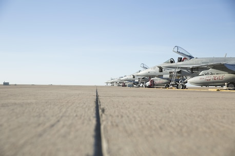 "Several F/A-18C Hornets with Marine Fighter Attack Squadron (VMFA) 232 ""Red Devils"" rest on the flight line prior to taking off from Marine Corps Air Station Mirimar, Calif., March 11. Marine Fighter Attack Squadron (VMFA) 232 ""Red Devils,"" the oldest Marine fighter attack squadron, will spend six months training in the Asia-Pacific region and northern America.  (U.S. Marine Corps photo by Sgt. David Bickel/Released)"