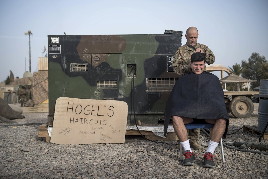 Army 1st Lt. Christopher McKinley receives a haircut from Sgt. Jeremy Hogel at an undisclosed location, March 12, 2017. McKinley and Hogel are assigned to the 82nd Airborne Division's 2nd Battalion, 325th Airborne Infantry Regiment, 2nd Brigade Combat Team. They also are deployed to support Combined Joint Task Force Operation Inherent Resolve, the global coalition to defeat the Islamic State in Iraq and Syria. Army photo by Staff Sgt. Alex Manne