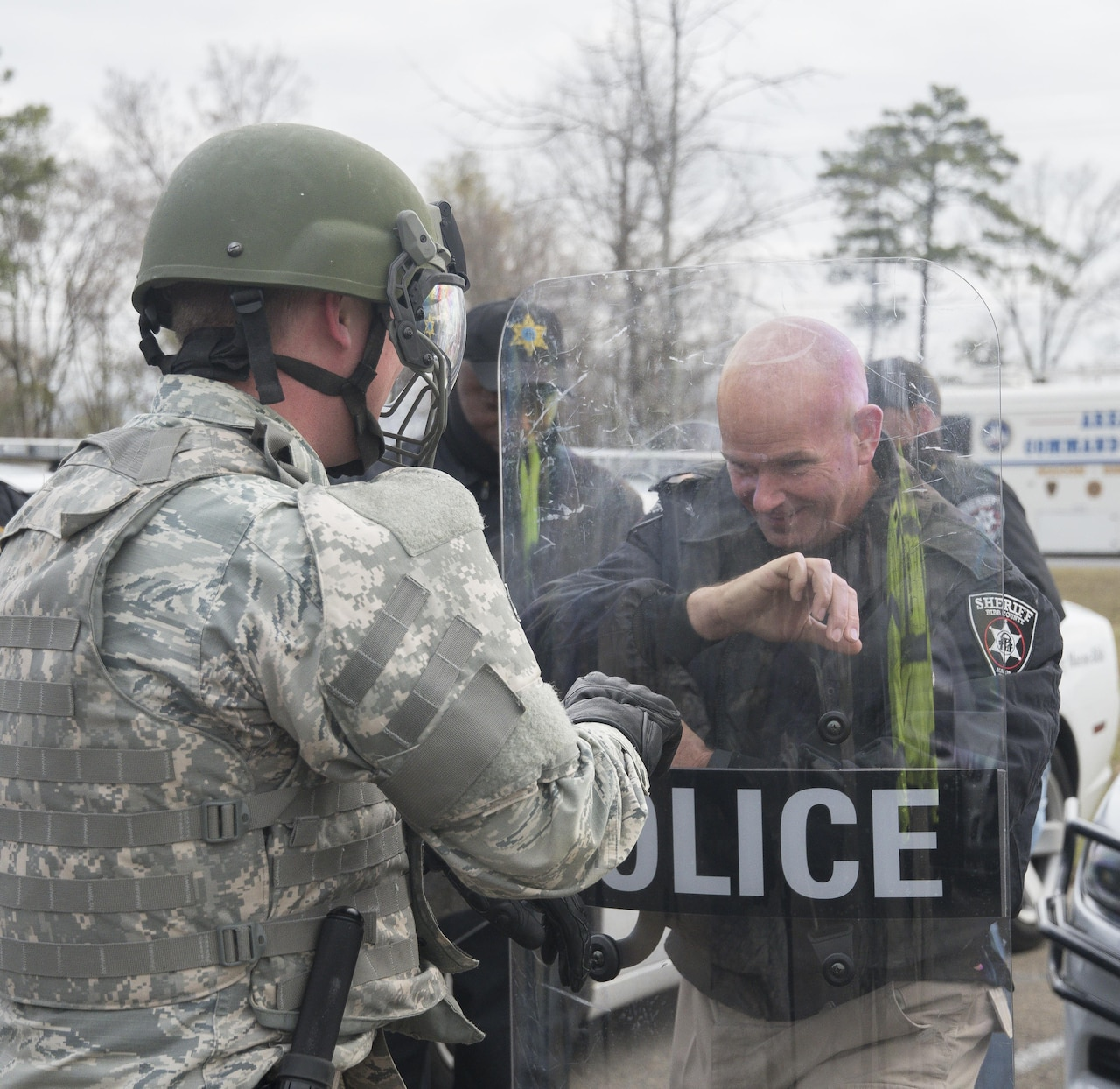 A Georgia Air National Guard security forces airman partners with Cpl. Greg Thomas, a police officer with the Macon-Bibb County Sheriff's Department, to practice crowd control techniques during exercise Vigilant Guard 2017 in Macon, Ga., March 14, 2017. The 116th Air Control Wing and the 165th Airlift Wing worked with the Macon-Bibb Emergency Management Agency and other agencies to practice crowd control techniques as part of a hurricane simulation to ensure the safety of citizens during possible natural disasters or catastrophes. Vigilant Guard Georgia 2017 is a joint regional training exercise sponsored by U.S. Northern Command in conjunction with the National Guard Bureau. Georgia Air National Guard photo by Master Sgt. Regina Young