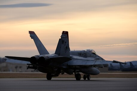 A pilot assigned to Marine Fighter Attack Squadron 232 out of Marine Corps Air Station Miramar, Calif., taxis his F/A-18C Hornet aircraft down the Eielson Air Force Base, Alaska, flight line as U.S. Air Force KC-135 Stratotanker aircraft wait in their ramp space in the background Oct. 10, 2016, during RED FLAG-Alaska (RF-A) 17-1. The Joint Pacific Alaska Range Complex provides more than 67,000 square miles of realistic training environment and allows commanders to train for full spectrum engagements, ranging from individual skills to complex, large-scale joint engagements. (U.S. Air Force photo by Master Sgt. Karen J. Tomasik)