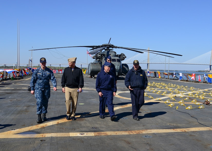 U.S. Navy amphibious dock landing ship USS Whidbey Island (LSD 41) visited Charleston, South Carolina over St. Patrick's day weekend. Lieutenant David Pagan gives a tour of ship USS Whidbey Island to U.S. Air Force Col. Richard Mathews, commander, 628th Mission Support Group, Lt. Col. Matthew Brennan, commander, 628th Civil Engineer Squadron, and Navy Cmdr. William Edenbeck, Naval Support Activity Charleston's Executive Officer. The Whidbey Island moored at Union Pier Terminal in downtown Charleston.