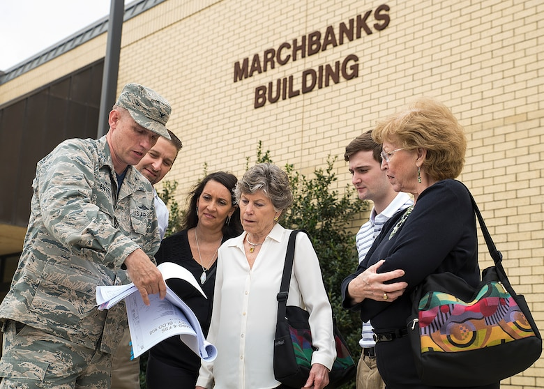Col. David Enfield, 433rd Mission Support Group commander, shows Peggy Marchbanks, the new-construction blueprints of the Marchbanks Building March 17, 2017 at Joint Base San Antonio-Lackland, Texas. Peggy Marchbanks  was accompanied by her son Tobin Marchbanks, daughter-inlaw Lorisha Marchbanks, grandson Colin Marchbanks, and sister Nancy Richter. She is the widow of Maj.Gen. Tom E. Marchbanks, Jr. , the first chief, Air Force Reserve, and former 433rd Airlift Wing commander. (U.S.  Air Force photo by Benjamin Faske)