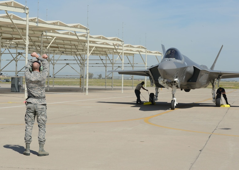 Airman 1st Class Joshua Cote, 61st Aircraft Maintenance Unit F-35 Lightning II crew chief, marshals an F-35 Lightning II March 20, 2017, at Luke Air Force Base, Ariz. This is the first F-35 for the 63rd FS and marks the 51st F-35 for Luke. (U.S. Air Force photo by Senior Airman James Hensley)