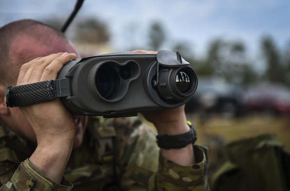A Soldier with the 1st Battalion, 10th Special Forces Group, uses a laser rangefinder at the Eglin Range, Eglin Air Force Base, Fla., March 17, 2017. Soldiers use the laser rangefinder to identify target location distance, day or night, and with limited visibility such as fog or smoke. (U.S. Air Force photo by Airman 1st Class Joseph Pick)