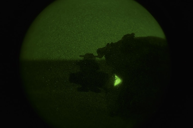 A Soldier with the 1st Battalion, 10th Special Forces Group, uses night vision goggles to participate in call-for-fire training at the Eglin Range, Eglin Air Force Base, Fla., March 17, 2017. The 1st Special Operations Support Squadron Operational Support Joint Office coordinates two-week long training programs for Army, Navy and Marine special operations forces that provides live-fire ranges and familiarizes them with Air Force Special Operations Command aircraft to ensure global readiness. (U.S. Air Force photo by Airman 1st Class Joseph Pick)