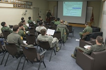 U.S. Air Force and Japan Air Self-Defense Force pilots sit in a dissimilar air combat-training brief at Misawa Air Base, Japan, March 17, 2017. During the brief, personnel discussed any mistakes, communication problems and tactic differences that occurred during the mission. (U.S. Air Force photo by Senior Airman Jarrod Vickers)