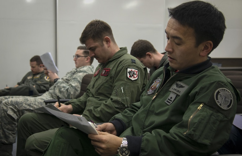 U.S. Air Force and Japan Air Self-Defense Force pilots sit through a dissimilar air combat-training brief at Misawa Air Base, Japan, March 17, 2017. The DAC-T allows for U.S. and JASDF pilots to identify any potential errors in their tactics, as well as visualize how working with other nations will be like during large force exercises. (U.S. Air Force photo by Senior Airman Jarrod Vickers)