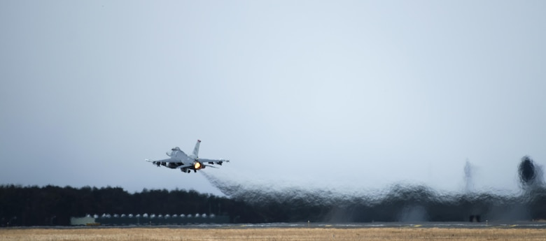 An F-16 Fighting Falcon takes off during a dissimilar air combat-training at Misawa Air Base, Japan, March 17, 2017. The DAC-T is a practice of using various aircraft, while integrating with other national forces, to execute one common goal. (U.S. Air Force photo by Senior Airman Jarrod Vickers)