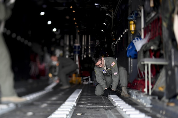 Airmen from the 374th Operations Group perform post flight operations after a C-130H Hercules returns from Exercise Cope North Guam, March 14, 2017, at Yokota Air Base, Japan. The exercise aims to cultivate regional ties and seeks to enhance the Air Force's interoperability with allied forces in the Endo-Asia Pacific region. (U.S. Air Force photo by Airman 1st Class Donald Hudson)