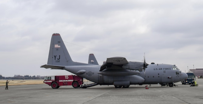 Senior Airman Aubrey Rice, 374th Civil Engineering Squadron driver operator, gets into a P-19 firetruck on the flight line after returning from Exercise Cope North Guam, March 14, 2017, at Yokota Air Base, Japan. The firetruck was used to provide flight line support during the exercise. (U.S. Air Force photo by Airman 1st Class Donald Hudson)