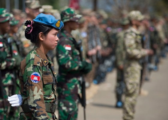 A Cambodian platoon leader stands in formation during the opening ceremony of Shanti Prayas III in Nepal. Shanti Prayas III is a multinational United Nations peacekeeping exercise designed to provide pre-deployment training to U.N. partner countries in preparation for real-world peacekeeping operations. (U.S. Navy Photo by Petty Officer 2nd Class Taylor Mohr)