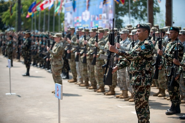 Multiple partner nations present arms in formation during the opening ceremony of exercise Shanti Prayas III in Nepal.  Shanti Prayas III is a multinational United Nations peacekeeping exercise designed to provide pre-deployment training to U.N. partner countries in preparation for real-world peacekeeping operations. (U.S. Navy Photo by Petty Officer 2nd Class Taylor Mohr)
