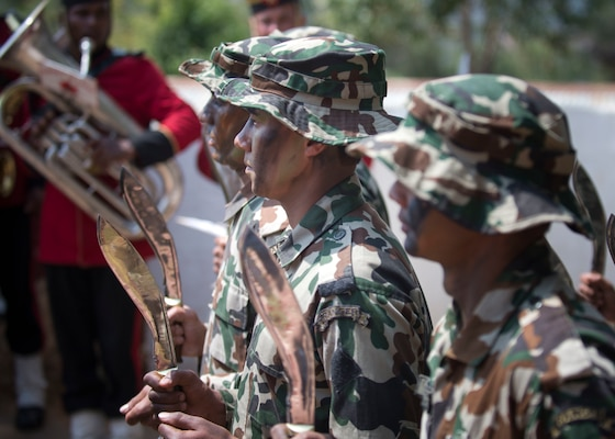 """Nepalese army rangers known as """"Ghurkas"""" perform a kukiri knife demonstration during the opening ceremony of exercise Shanti Prayas III in Nepal. Shanti Prayas III is a multinational United Nations peacekeeping exercise designed to provide pre-deployment training to U.N. partner countries in preparation for real-world peacekeeping operations. (U.S. Navy Photo by Petty Officer 2nd Class Taylor Mohr)"""
