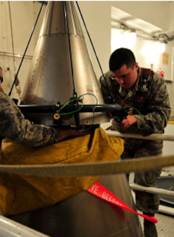 """U.S. Air Force Staff Sergeant Wesley Baptiste and Airman Daniel Peryer perform a """"simulated missile reduction"""" in accordance with the New Strategic Arms Reduction Treaty at Minot Air Force Base, North Dakota, November 29, 2011."""