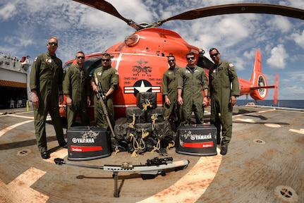 The aircrew of the Florida-based Coast Guard Helicopter Interdiction Tactical Squadron stand for a photo after the 500th recorded drug bust in the Eastern Pacific Ocean, March 11, 2017. U.S. Coast Guard photo.