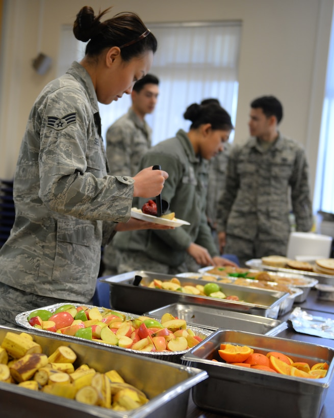 U.S. Air Force Airmen prepare their plates at the base chapel March 21, 2017, on RAF Mildenhall, England. The Airmen Committed to Excellence council hosted a free breakfast for Team Mildenhall's Airmen. The ACE council enables Airmen the opportunity to give back to military and local communities through community service. (U.S. Air Force photo by Staff Sgt. Micaiah Anthony)
