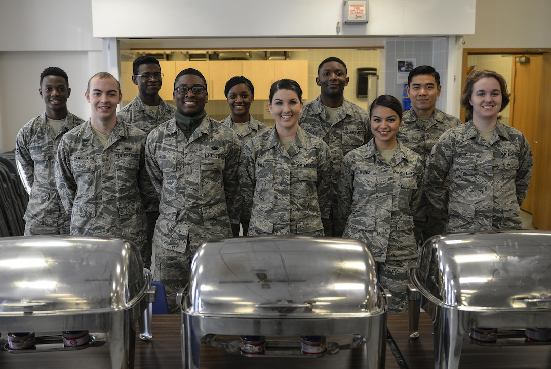Volunteers and members of the Airmen Committed to Excellence council pose for a photo at the base chapel March 21, 2017, on RAF Mildenhall, England. The ACE council prepared and served free breakfast for junior enlisted personnel across base. (U.S. Air Force photo by Staff Sgt. Micaiah Anthony)