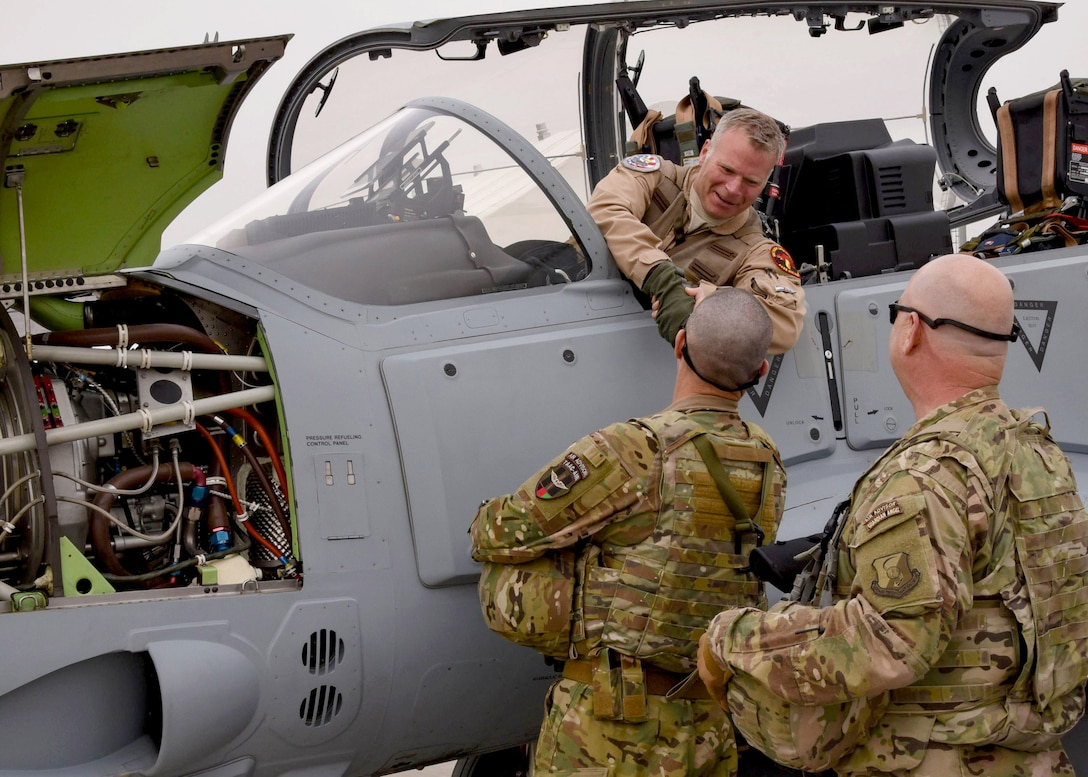 Train, Advise, Assist Command-Air (TAAC-Air) advisors welcome a U.S. pilot after transporting an A-29 Super Tucano light-attack aircraft arriving for duty at Kabul Air Wing, Kabul, Afghanistan, March 20, 2017. The A-29s will be used by the Afghan Air Force for close-air attack, air interdiction, escort and armed reconnaissance. These latest arrivals, which traveled from Moody Air Force Base, Ga., bring the AAF A-29 inventory from eight to 12 aircraft in country. (U.S. Air Force photo by Tech. Sgt. Veronica Pierce)