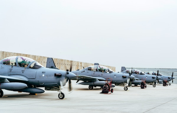 Four A-29 Super Tucanos arrive at Kabul Air Wing, Kabul, Afghanistan, March 20, 2017, before the beginning of the 2017 fighting season. The aircraft will bolster the Afghan Air Force's inventory from eight to 12 A-29s in country. Airmen from Train, Advise, Assist Command-Air, as part of Resolute Support Mission, work shoulder-to-shoulder with their Afghan counterparts fostering a working relationship and fortifying confidence in the mission. (U.S. Air Force photo by Senior Airman Jordan Castelan)