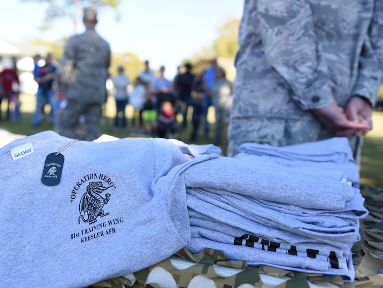 T-shirts and dog tags sit on display during Operation Hero March 18, 2017, on Keesler Air Force Base, Miss. The activities at the event were designed to help children better understand what their parents do when they deploy. (U.S. Air Force photo by Kemberly Groue)