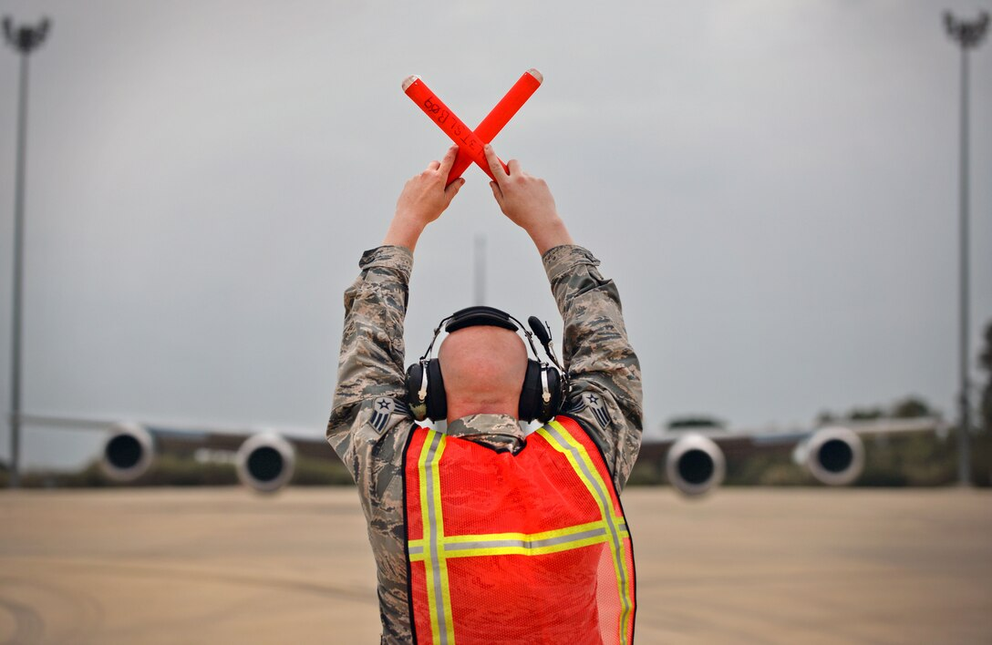 U.S. Air Force Senior Airman Keiven Polm, 100th Aircraft Maintenance Squadron KC-135 Stratotanker crew chief, marshals a KC-135 Stratotanker off the flightline March 16, 2017, at Naval Station Rota, Spain. The 100th ARW Airmen are currently providing air refueling support for French Forces combat operations in Mali and North Africa. (U.S. Air Force photo by Senior Airman Christine Halan)