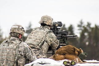 An Army reservist fires the MK-19 grenade launcher during Operation Cold Steel at Fort McCoy, Wis., March 13, 2017. The soldier is assigned to the 327th Engineer Company, 416th Theater Engineer Command. Army Reserve photo by Spc. Maurice Cheeks