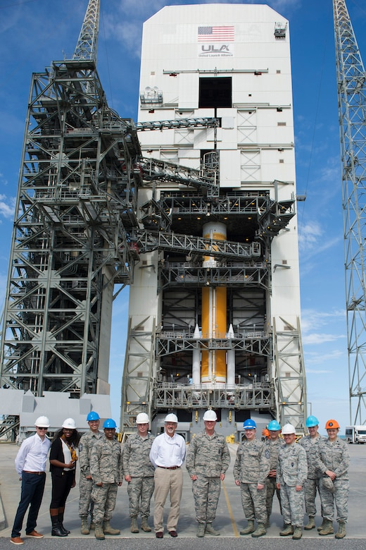 "Gen. Jay Raymond, commander of Air Force Space Command, members of the 45th Launch Group and members of United Launch Alliance, tour the Delta IV Space Launch Complex 37, March 8, 2017, at Cape Canaveral Air Force Station, Fla. The tour included a close up view of the WGS-09 payload fairing, which was adorned with the 70th Anniversary ""U.S. Air Force Breaking Barriers"" emblem. (U.S. Air Force photo/Matthew Jurgens)"