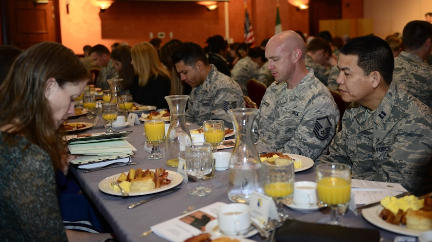 National Prayer Breakfast attendees pause for prayer at Aviano Air Base, Italy, March 20, 2017. The event featured various religious text readings and a speech from Maj. Gen. Dondi Costin, U.S. Air Force chief of chaplains. (U.S. Air Force photo by Staff Sgt. Krystal Ardrey)