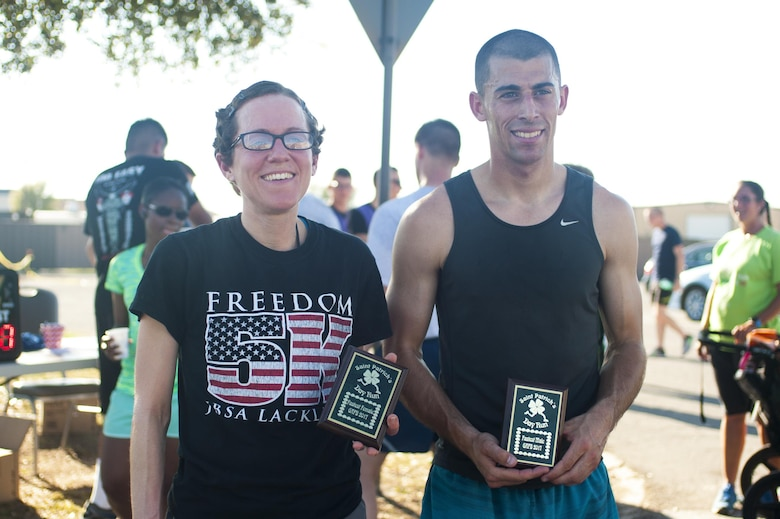 U.S. Air Force Airman 1st Class Bretta Jones, 316th Training Squadron student, and Airman 1st Class Jacob Bull, 312th Training Squadron student, show their trophies for winning the St. Patrick 's day fun-run on Goodfellow Air Force Base, Texas, March 17th, 2017. Bull trains in his off time for marathons. (U.S. Air Force photo by Senior Airman Scott Jackson/Released)