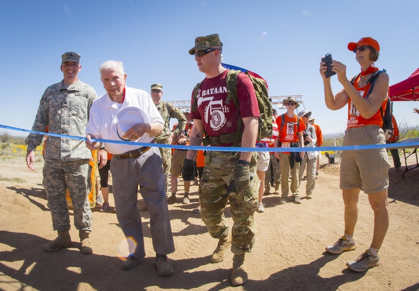 Ben Skardon, 99, a retired Army colonel and a survivor of the Bataan Death March, crosses the eight-and-a-half mile finish line at the Bataan Memorial Death March observance at White Sands Missile Range, N.M., March 19, 2017. Army photo by Staff Sgt. Ken Scar