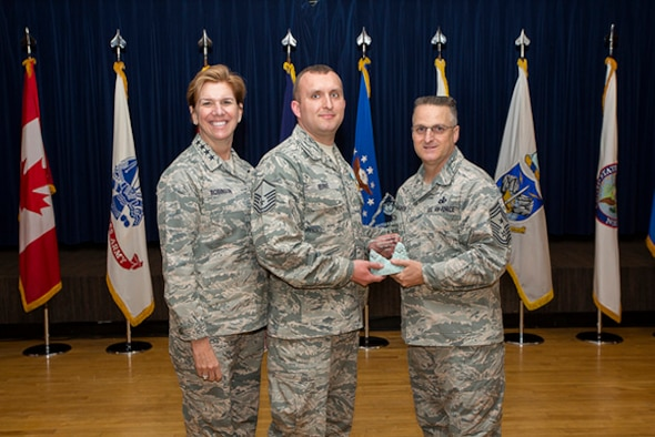 Master Sgt. James Burke of the 224th ADG received NORAD Senior NCO of the Year award on March 14 from NORAD Commander Gen. Lori Robinson and NORAD Command SEL Chief Master Sgt. Harold Hutchison. Photo courtesy of NORAD Public Affairs.