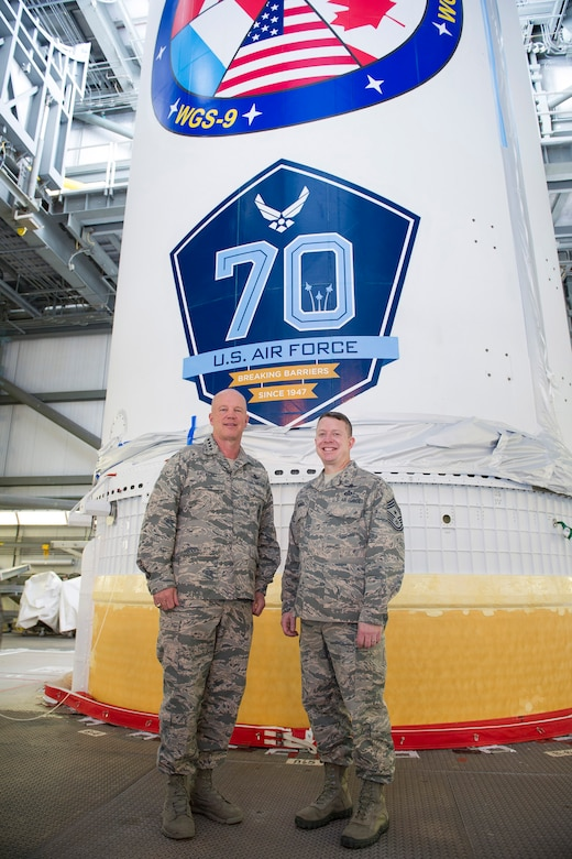 Gen. Jay Raymond, commander of Air Force Space Command and Chief Master Sgt. Brendan Criswell, AFSPC command chief, March 8, 2017, stand in front of a Delta IV at Space Launch Complex 37, at Cape Canaveral Air Force Station, Fla. The tour included a close up of the WGS-09 payload, which adorned the 70th Anniversary U.S. Air Force Breaking Barriers emblem. (U.S. Air Force photo/Matthew Jurgens)