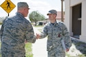 Gen. Jay Raymond, commander of Air Force Space Command, shakes hands with Lt. Col. Jason Glynn, 45th Civil Engineer Squadron commander, during a tour of Patrick Air Force Base, Fla. March 8, 2017. Members of the 45th CES showed Raymond the significant upgrades to the infrastructure here to include the dormitory, fitness center, and the military working dog obedience yard.  (U.S. Air Force photo/Matthew Jurgens)