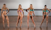 Bodybuilding competitors strike poses during their Bikini - Short Class category judging during the Eglin Bodybuilding Classic contest March 18 at Eglin Air Force Base, Fla.  Four men and 10 women competed in various categories highlighting their fit and sculpted physiques. (U.S. Air Force photo/Samuel King Jr.)