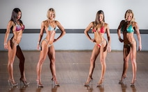 Bodybuilding competitors strike poses during their Bikini - Tall Class category judging at the Eglin Bodybuilding Classic contest March 18 at Eglin Air Force Base, Fla.  Four men and 10 women competed in various categories highlighting their fit and sculpted physiques. (U.S. Air Force photo/Samuel King Jr.)