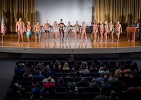All of the bodybuilding competitors stand on stage and receive applause during the Eglin Bodybuilding Classic contest March 18 at Eglin Air Force Base, Fla.  Four men and 10 women competed in various categories highlighting their fit and sculpted physiques. (U.S. Air Force photo/Samuel King Jr.)