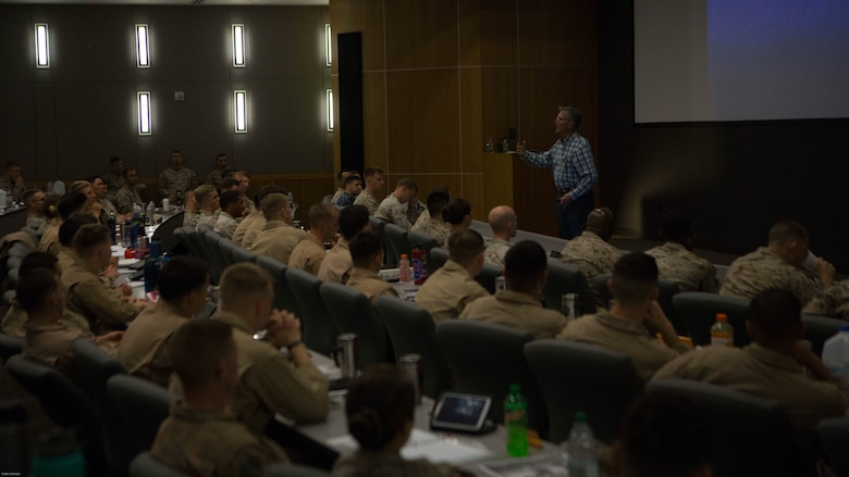 Mr. Beard, former Marine Corps aviator addresses students attending Weapons and Tactics Instructor Course 2-17 and Marine Aviation Weapons and Tactics Squadron One staff during a tactical risk management period of instruction at Marine Corps Air Station Yuma, Ariz., March 15, 2017.  WTI is a seven week event hosted by MAWTS-1. MAWTS-1 provides standardized tactical training and certification of unit instructor qualifications to support Marine Aviation Training and Readiness and assists in developing and employing Aviation Weapons and Tactics.