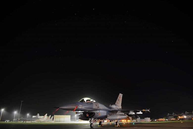 The U.S. Air Force 354th Operations Group F-16 Fighting Falcon flagship sits on the tarmac at Royal Australian Air Force Base Williamtown, in New South Wales, Australia, March 19, 2017. Exercise Diamond Shield 2017, the second of four Diamond Series exercises conducted by the RAAF Air Warfare Centre, is an Australian Defence Force training activity where high-readiness forces deploy quickly to remote locations in Australia in response to a simulated security threat. The exercise will see members of the ADF Navy, Army and Air Force rapidly deploy to counter a fictitious force posing a threat to Australia's national security in the Kimberley region in North Western Australia. (U.S. Air Force photo by Tech. Sgt. Steven R. Doty)