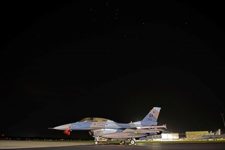 A U.S. Air Force F-16 Fighting Falcon sits under the night sky at Royal Australian Air Force Base Williamtown, in New South Wales, Australia, March 19, 2017. As a benchmark for aerial combat training through its annual series of Red Flag-Alaska exercises, integration of Eielson's 18th Aggressor pilot's enhances interoperability and ensures the RAAF can operate in a combined environment to respond to any contingency in the region and provide an agile, decisive and effective deterrent to any future challenges. (U.S. Air Force photo by Tech. Sgt. Steven R. Doty)