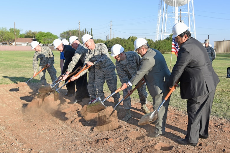 U.S. Air Force Col. Michael Downs, 17th Training Wing Commander, and team Goodfellow members break ground for the new temporary lodging facility near the base theater on Goodfellow Air Force Base, Texas March 20, 2017. The new TLF building is due for completion in late 2018. (U.S. Air Force photo by Staff Sgt. Joshua Edwards/Released)