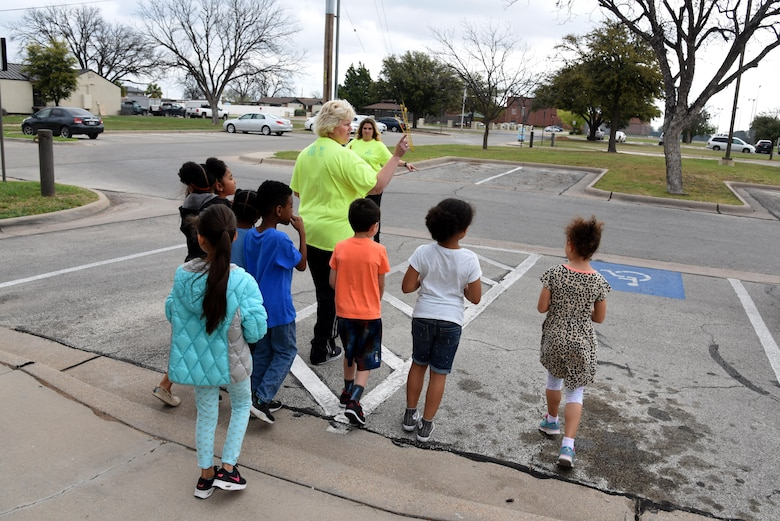 Catie Widenhofer, radKIDs instructor, teaches children to look both ways during a radKIDS class at the Youth Center on Goodfellow Air Force Base, Texas, March 16, 2017. radKIDS is a weeklong course teaching children various safety lessons. (U.S. Air Force photos by Staff Sgt. Joshua Edwards/Released)