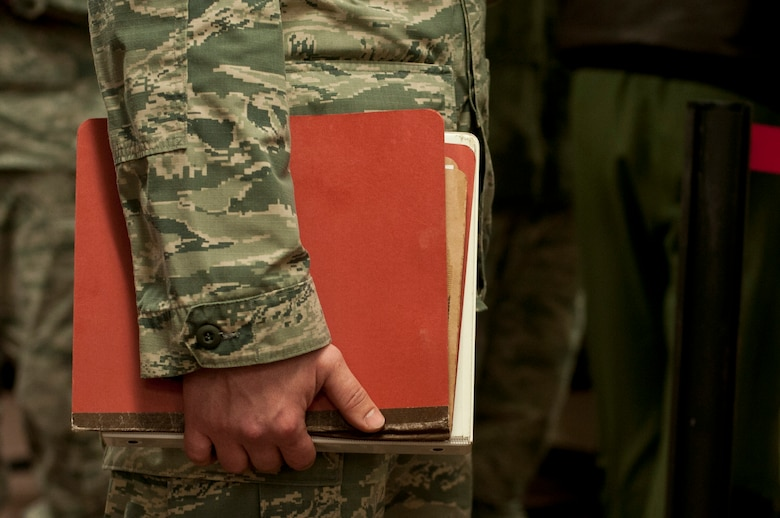 An Airman with the 5th Munitions Squadron holds a deployment folder at Minot Air Force Base, N.D., Feb. 23, 2017. The personnel deployment function line provides services from various units including the 5th Force Support Squadron, medical, chapel and finance. (U.S. Air Force photo/Airman 1st Class Jonathan McElderry)