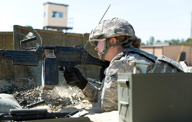 Airman 1st Class Annamae Prentiss, 436th Security Forces Squadron response force member, fires a M-249 Light Machine Gun at decommissioned tanks placed at various distances between 200 to 1,200 meters down range, March 9, 2017, at Range 7 on Joint Base McGuire-Dix-Lakehurst, N.J. Prentiss, assigned to Dover Air Force Base, Del., fired the M-249 loaded with 200 rounds of 5.56mm ammunition containing green-tipped frangible and orange/red-tipped tracer rounds placed in an assault pack. (U.S. Air Force photo by Roland Balik)
