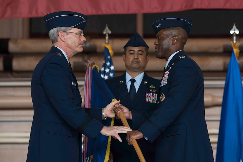 Maj. Gen. Robert Labrutta (left), 2nd Air Force commander, passes the ceremonial guidon to Col. Ronald Jolly (right), incoming 82nd Training Wing commander, during the 82nd Training Wing Change of Command ceremony at Sheppard Air Force Base, Texas, March 21, 2017. Jolly served at the Pentagon before arriving to Sheppard. (U.S. Air Force photo by Staff Sgt. Kyle E. Gese)