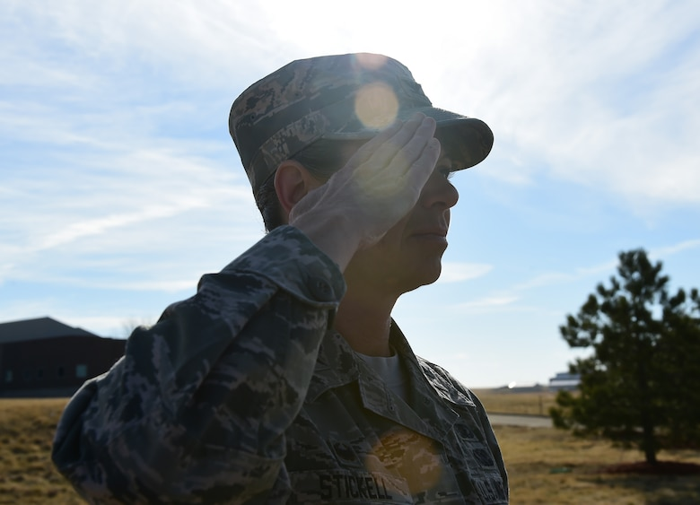 Col. Carolyn Stickell, Headquarters Individual Reservist Readiness and Integration Organization commander, renders a final salute to Senior Airmen Tien Tran, 566th Intelligence Squadron, March 21, 2107, on Buckley Air Force Base, Colo. Tran was tragically killed in a snowboarding accident earlier this month. Members of Team Buckley paid their last respects to Tran and his family at a funeral procession on Buckley AFB. (U.S. Air Force photo by Airman Jacob Deatherage/Released)