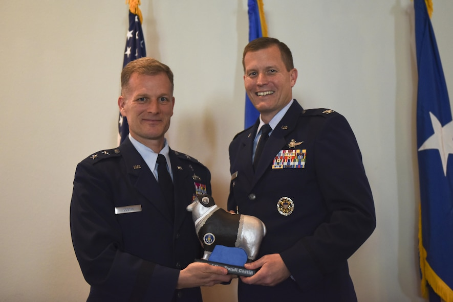 U.S. Air Force Col. Jeffrey Sorrell, 17th Training Wing Vice Commander, presents Chaplain (Maj. Gen.) Dondi Costin, Air Force Chief of Chaplains, with a miniature sheep at the Event Center on Goodfellow Air Force Base, Texas, March 15, 2017. The sheep represents the Doolittle Raiders and the local community's main livestock. (U.S. Air Force photo by Airman 1st Class Chase Sousa/Released)